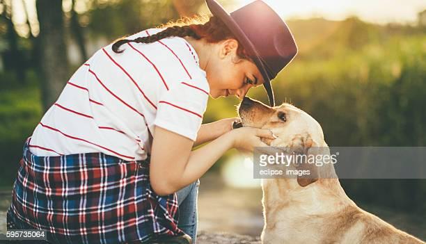 Teen girl loving her dog