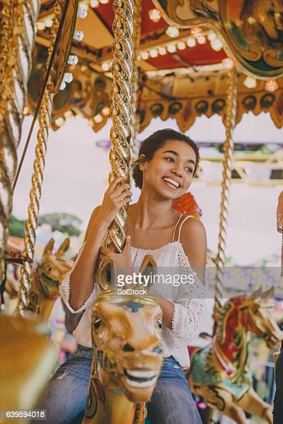Teen Girl on a Merry go round!