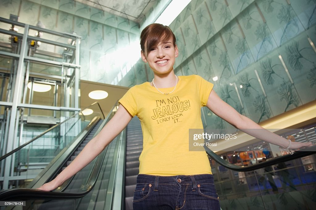 Teen girl on escalator : Stock Photo