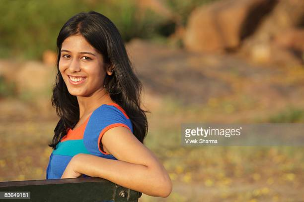 teen girl on park bench - one teenage girl only stock pictures, royalty-free photos & images