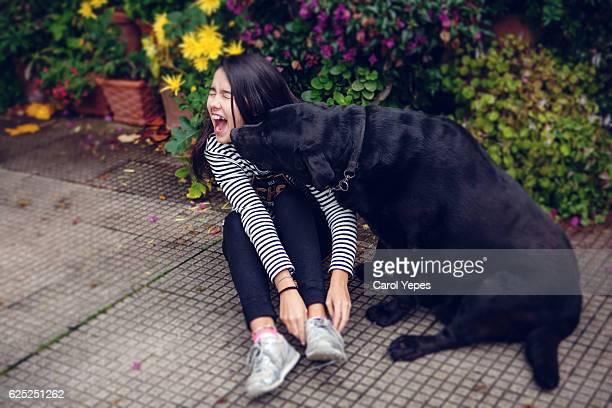 teen girl playing labrador retriever