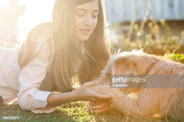 Teen Girl Playing with Dog