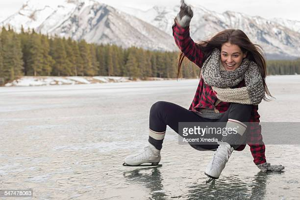 Teen girl slips while skating on mountain lake