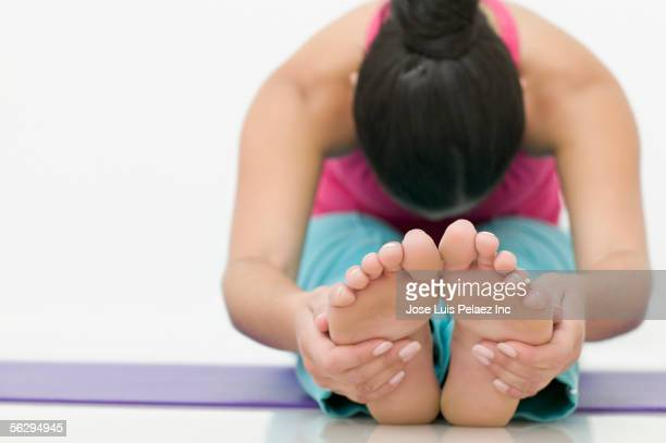 teen girl stretching for her toes - teen girls toes stock photos and pictures