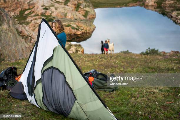 teen girl taking down tent in colorado mountains - takedown stock pictures, royalty-free photos & images
