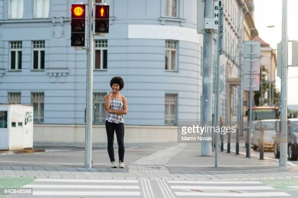 teen girl waiting to crosswalk street at zebra crossing - pedestrian crossing stock photos and pictures