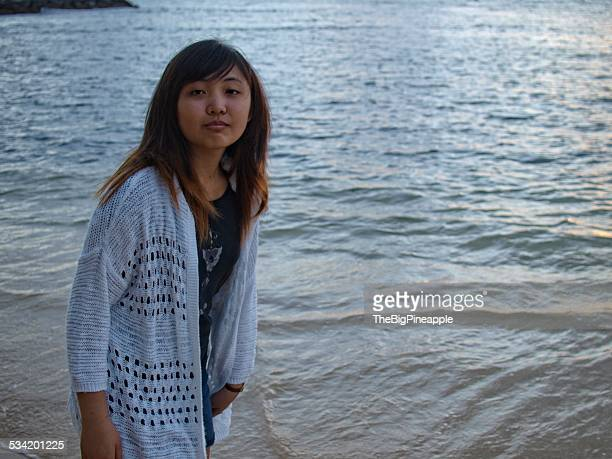Teen girl walking on beach