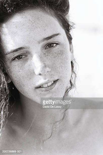 Teen girl with curly hair, portrait