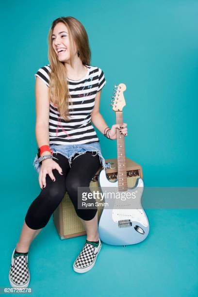 teen girl with electric guitar - girls in plaid skirts stock photos and pictures