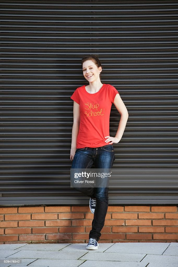 Teen girl with hand on hip : Stock Photo