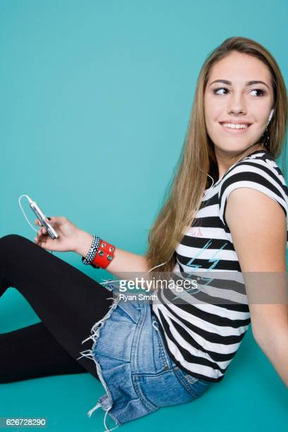 Teen girl with mp3 player
