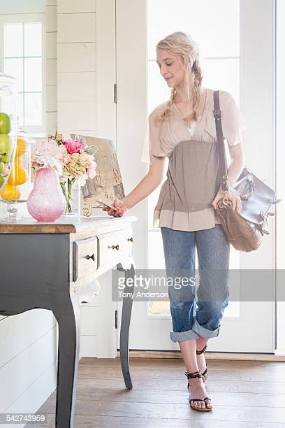 teen girl with phone in entry way at home - idaho falls stock photos and pictures