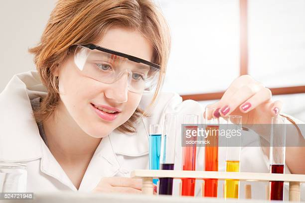 Teen Girl With Test Tubes Close Up