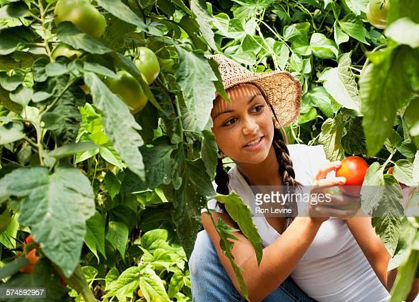 Teen girl working on an organic farm