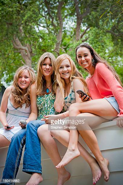 4 teen girls, affectionate backyard portrait