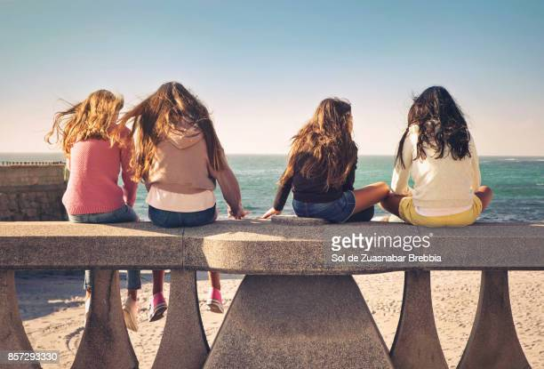 Teen girls, and pre teen sisters enjoying together on a beautiful sunny day.