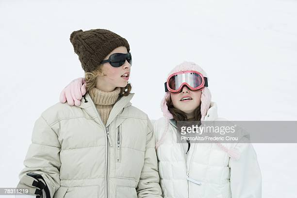 Teen girls dressed in ski gear