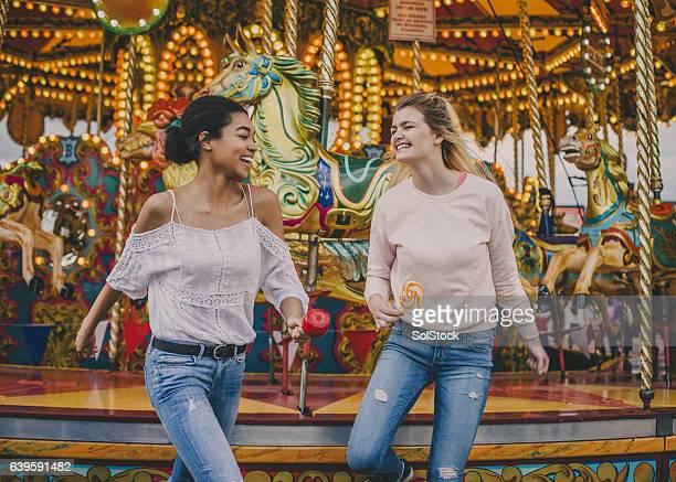 Teen Girls Getting off Merry Go Round