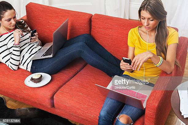 Teen (16-17) girls hanging out on couch