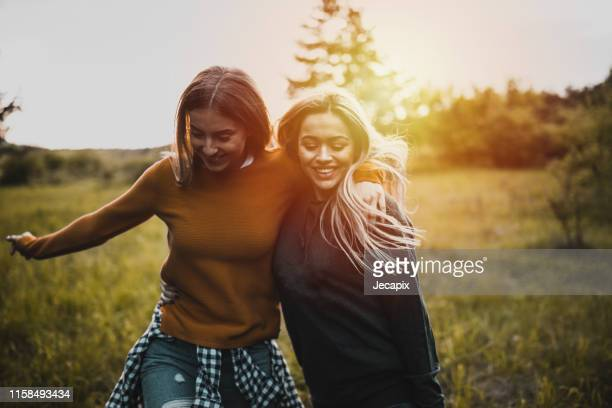 teen girls having fun at sunset - girls stock pictures, royalty-free photos & images
