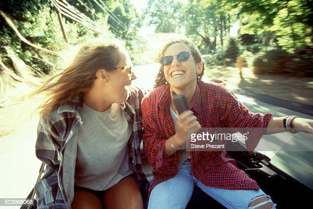 Teen girls in a convertible