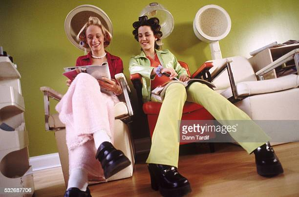 teen girls in hair curlers - vogue stock pictures, royalty-free photos & images