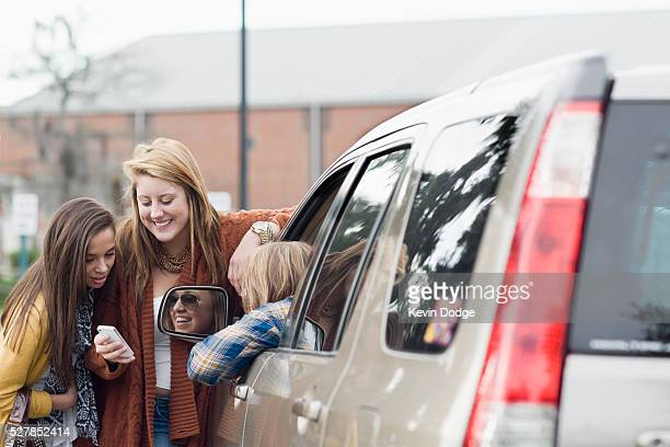 teen girls in school parking lot - gossip stock pictures, royalty-free photos & images