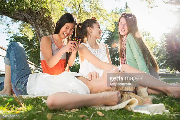 teen girls laughing outdoors - idaho falls stock photos and pictures
