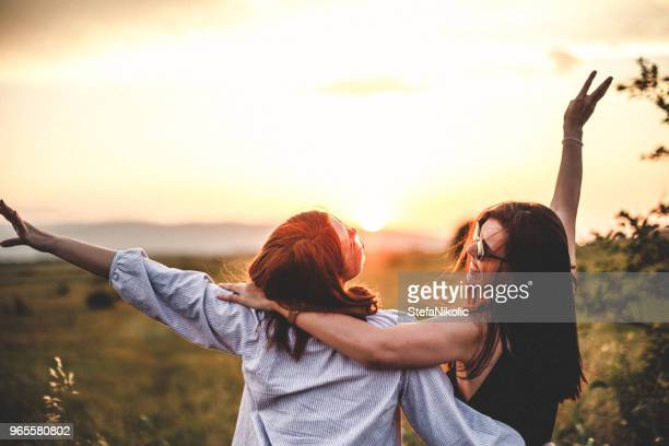 teen girls look at the sunset - friends stock pictures, royalty-free photos & images