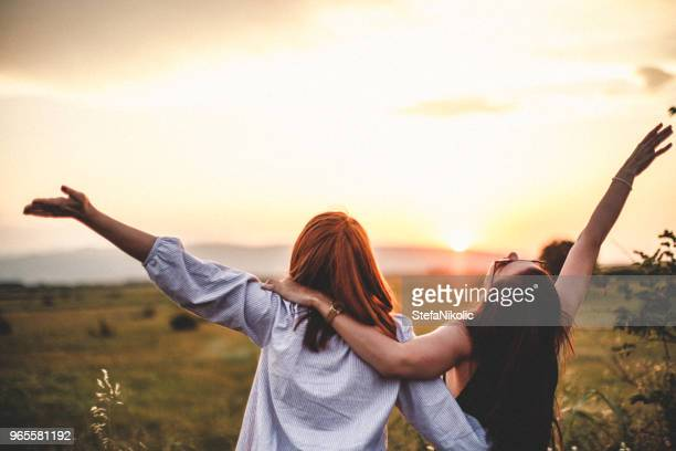 Teen girls look at the sunset