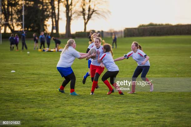 Teen Girls Playing a Game of Rugby