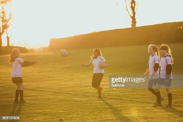 teen girls playing a game of rugby - girl power stock photos and pictures