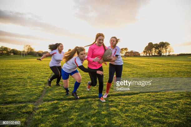 teen girls playing a game of rugby - rugby stock pictures, royalty-free photos & images