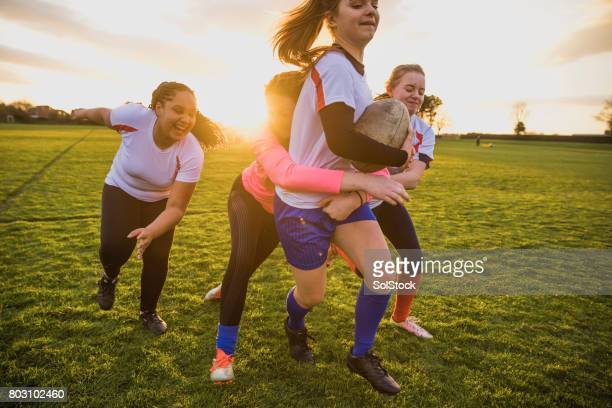 teen girls playing a game of rugby - rugby team stock pictures, royalty-free photos & images