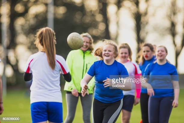 teen girls playing rugby - amateur stock pictures, royalty-free photos & images