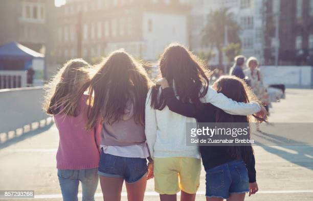 Teen girls walking together on a beautiful sunny day.