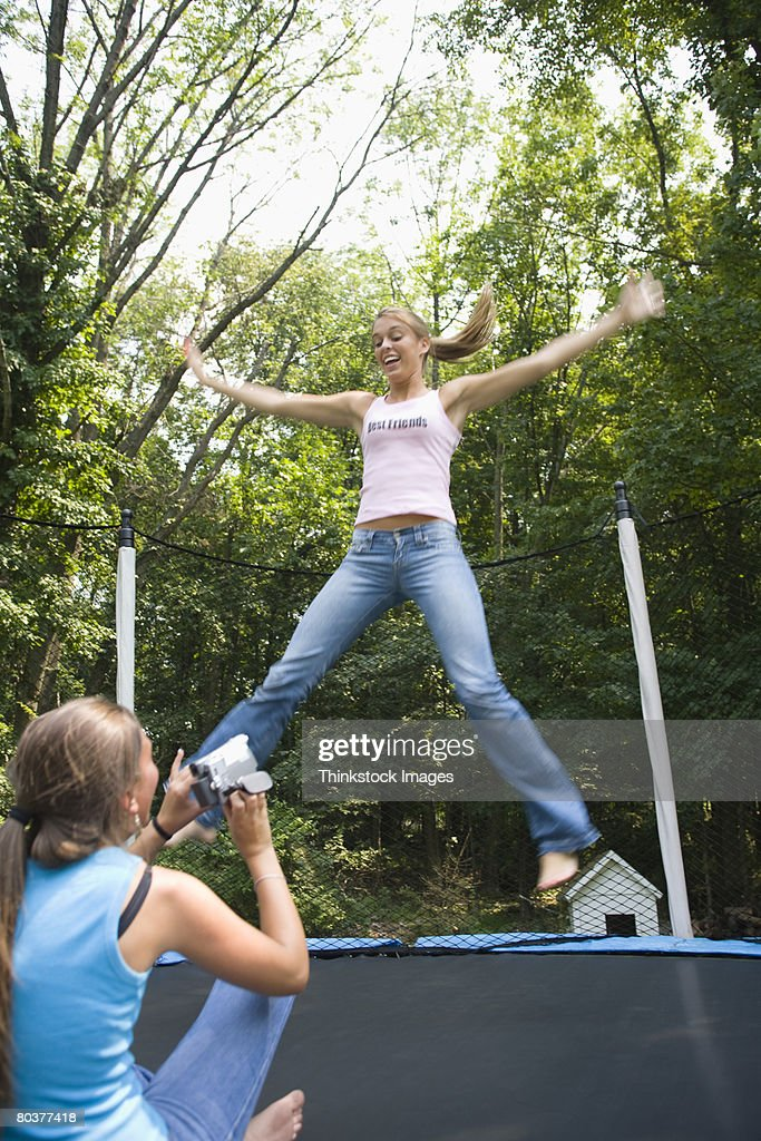 Teen Girls With Trampoline And Video Camera High-Res Stock -6771