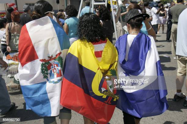 Teen girls wrapped in flags at Carnival Miami.