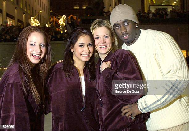 Teen group 'Dream' and Sean 'Puffy' Combs attend the Sean John Boys and Vibe Magazine Holiday Skating Party December 5 2001 at Rockefeller Plaza...