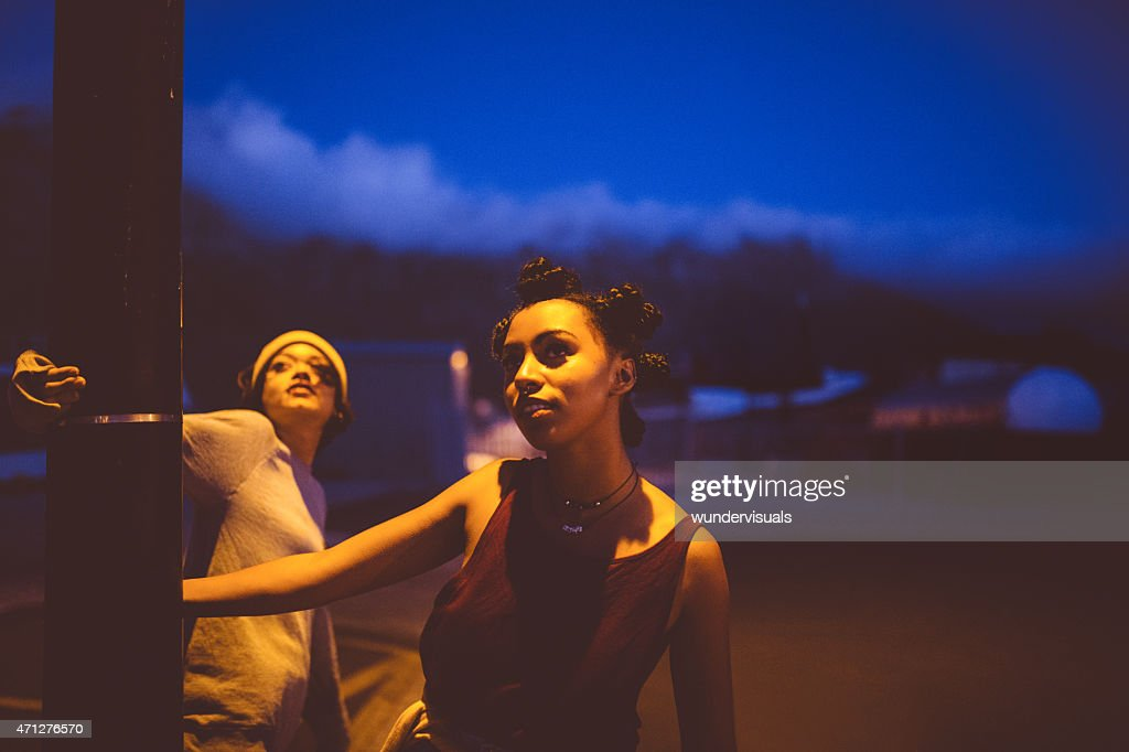 Teen grunge girls hanging out under a street light : Stock Photo