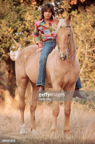 Teen heartthrob David Cassidy of the Partridge Family television show sits on a horse