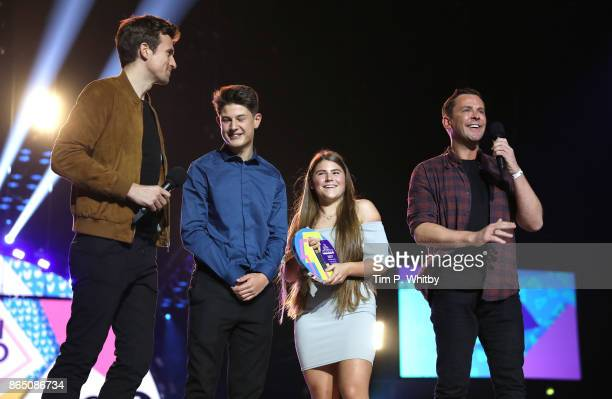 Teen Hero Award Winners Ollie and Holly with presenters Greg James and Scott Mills at the BBC Radio 1 Teen Awards 2017 at Wembley Arena on October 22...