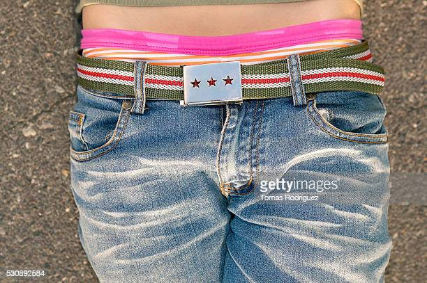 Teen hips with jeans and belt