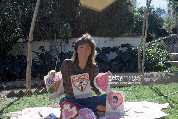 Teen idol David Cassidy aka Keith Partridge the lead singer of 'The Partridge Family' poses for a portrait with love letters from fans in February...