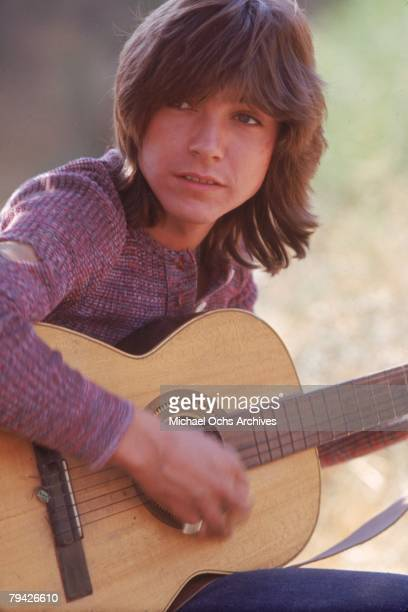 Teen idol David Cassidy aka Keith Partridge the lead singer of 'The Partridge Family' poses for a portrait with an acoustic guitar in September 1971