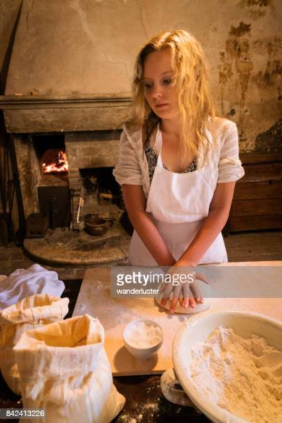 Teen making bread by hand
