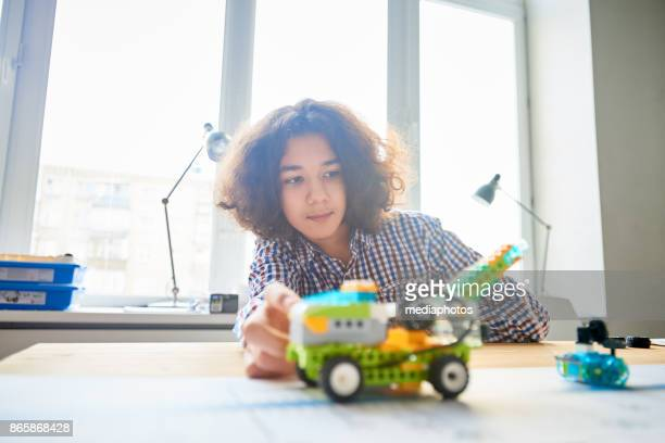 teen making personal discovery with robotics - inventor stock pictures, royalty-free photos & images