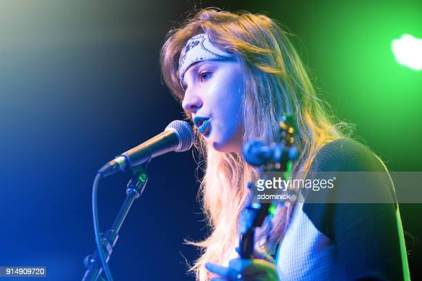teen musician performing rock concert - blonde female singers stock photos and pictures