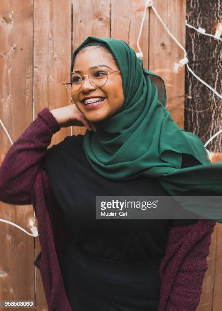 teen muslim girl wearing green hijab at a birthday party - muslimgirlcollection stock pictures, royalty-free photos & images
