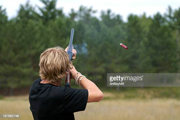 teen shooting a gun - clay pigeon shooting stock pictures, royalty-free photos & images